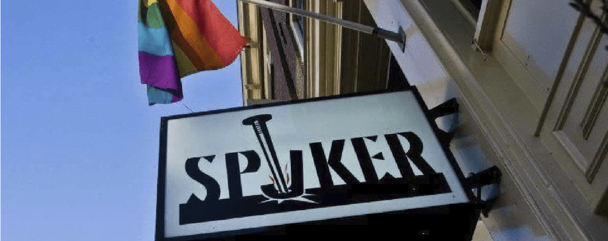 The sign outside Spijker Bar with a rainbow flag